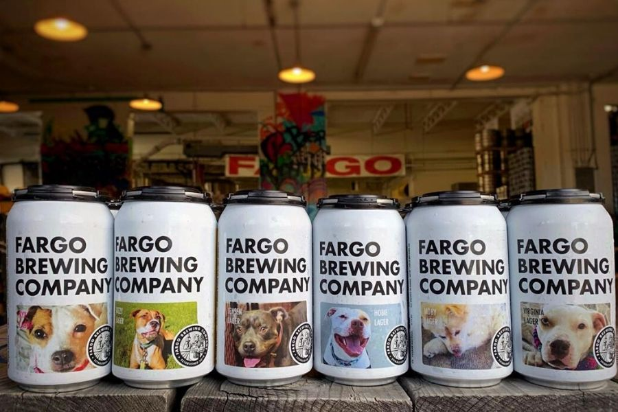 beer cans with dog faces on them