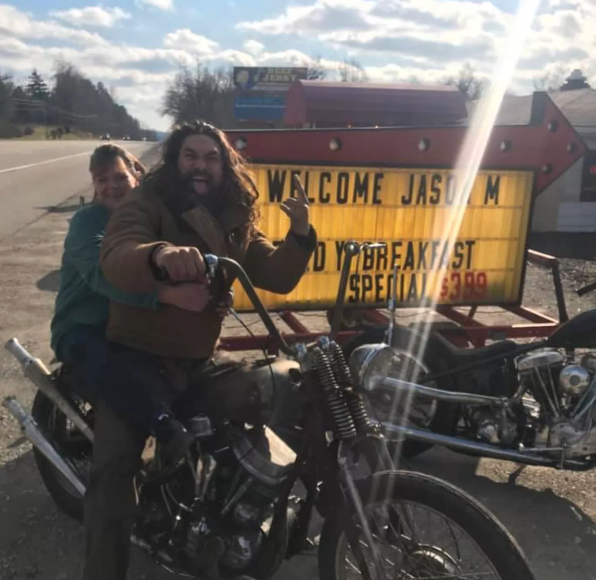 Jason with owner on back of his motorcycle