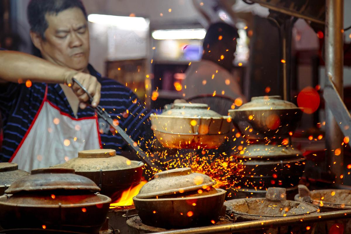 sparks flying as man cooks in restaurant