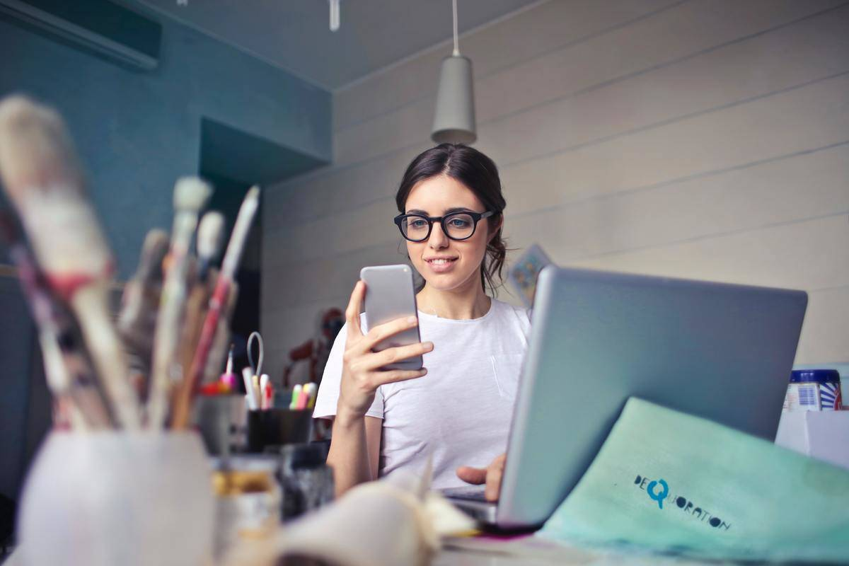 woman on phone and computer