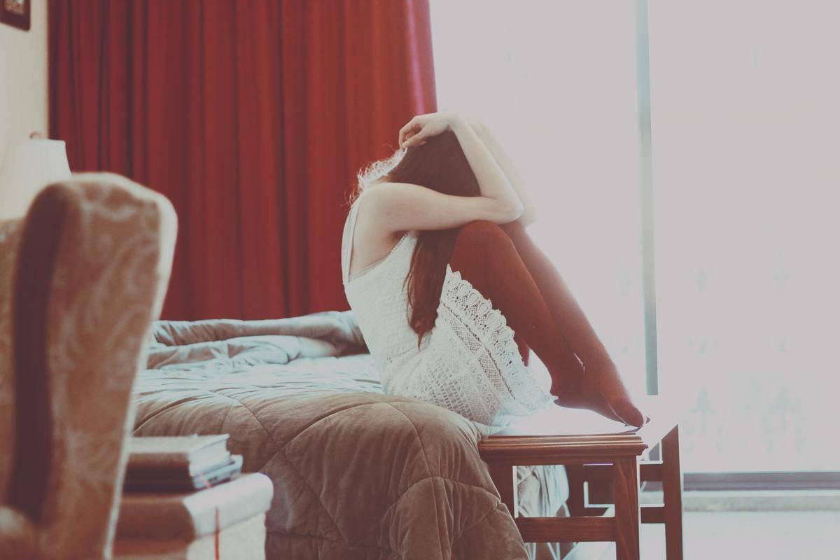 woman sad at home