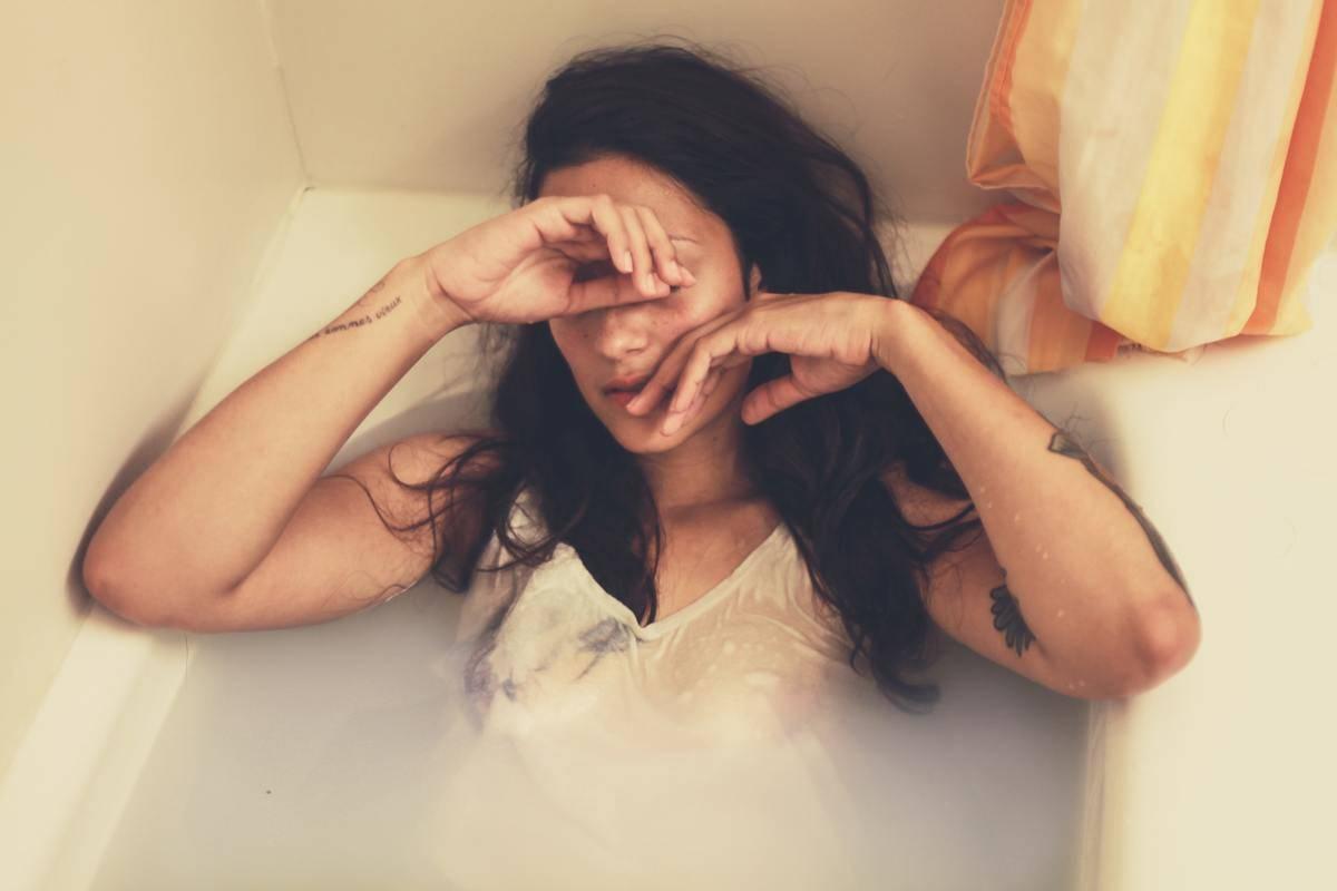 sad woman in tub