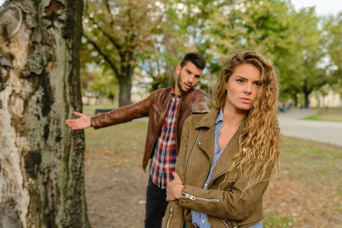 woman walking away from man while talking