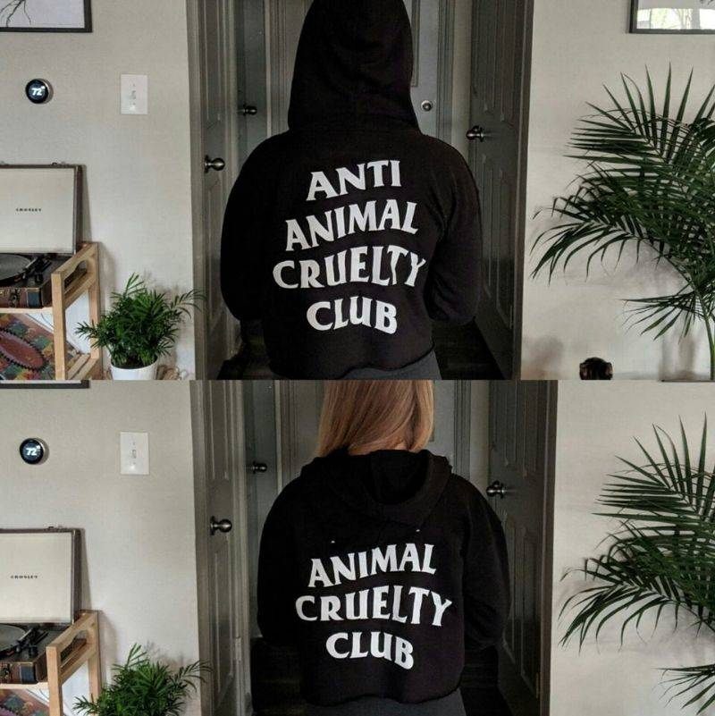 with the hood down, a sweater says animal cruelty club