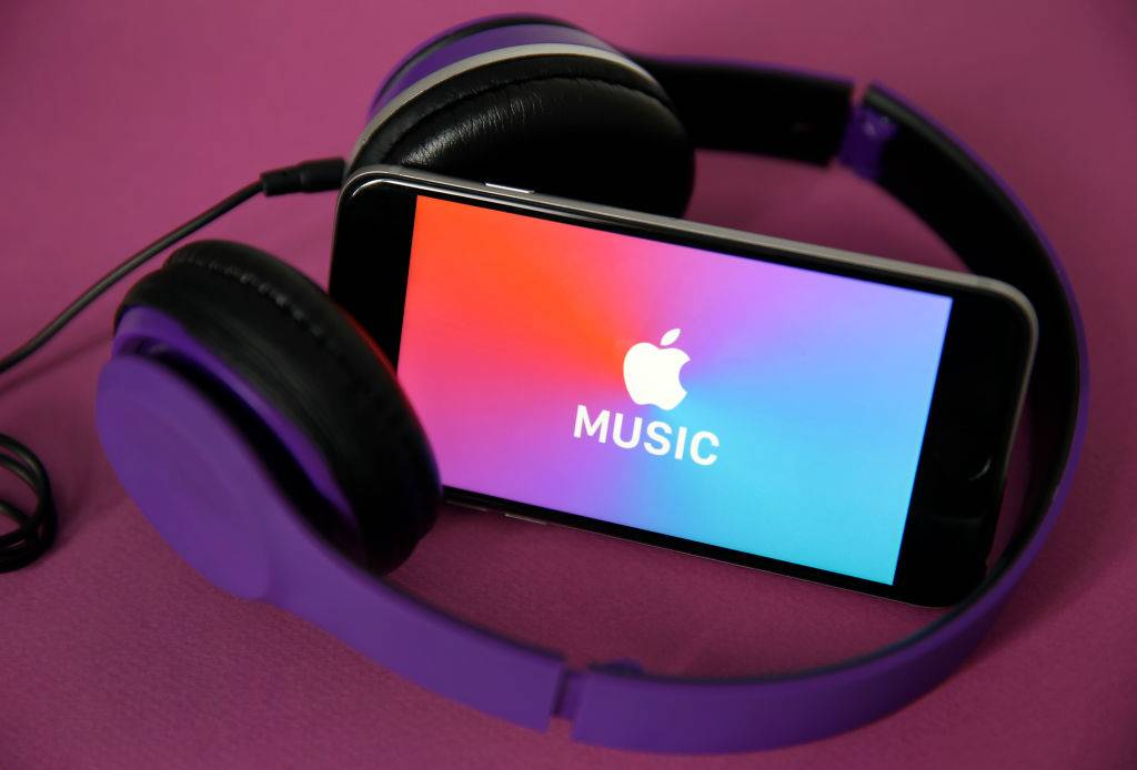 Logo of the music streaming platform Apple Music is displayed on the screen of an iPhone