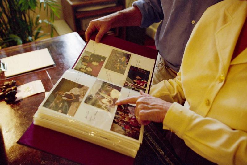 people look through photo album