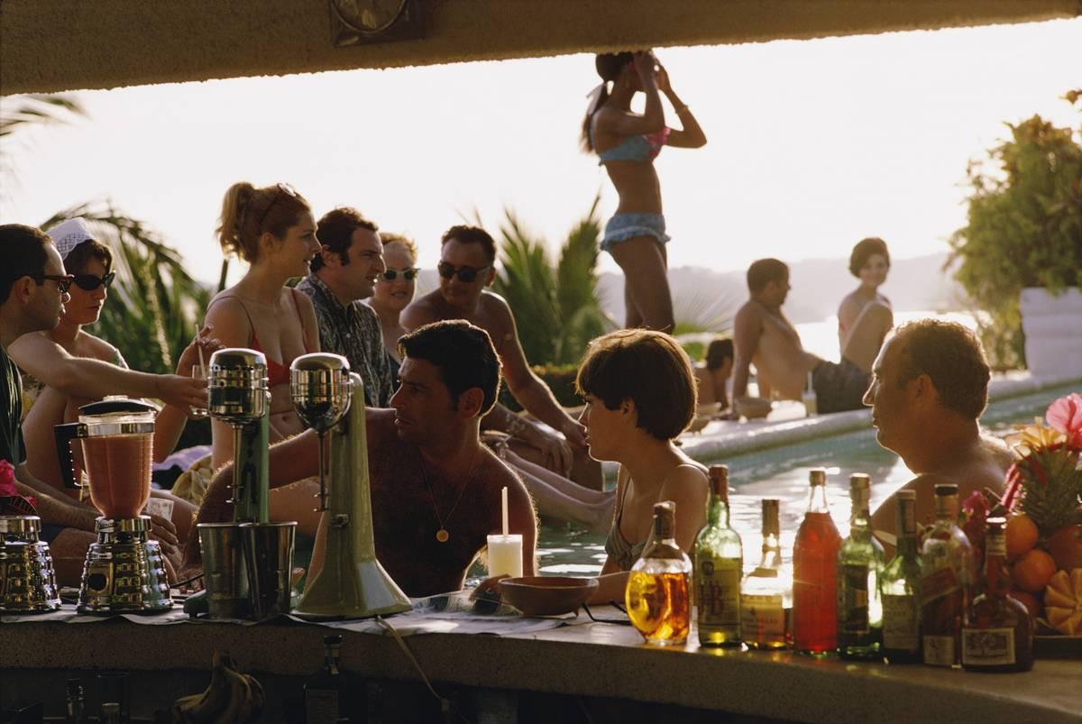 people talking at pool bar