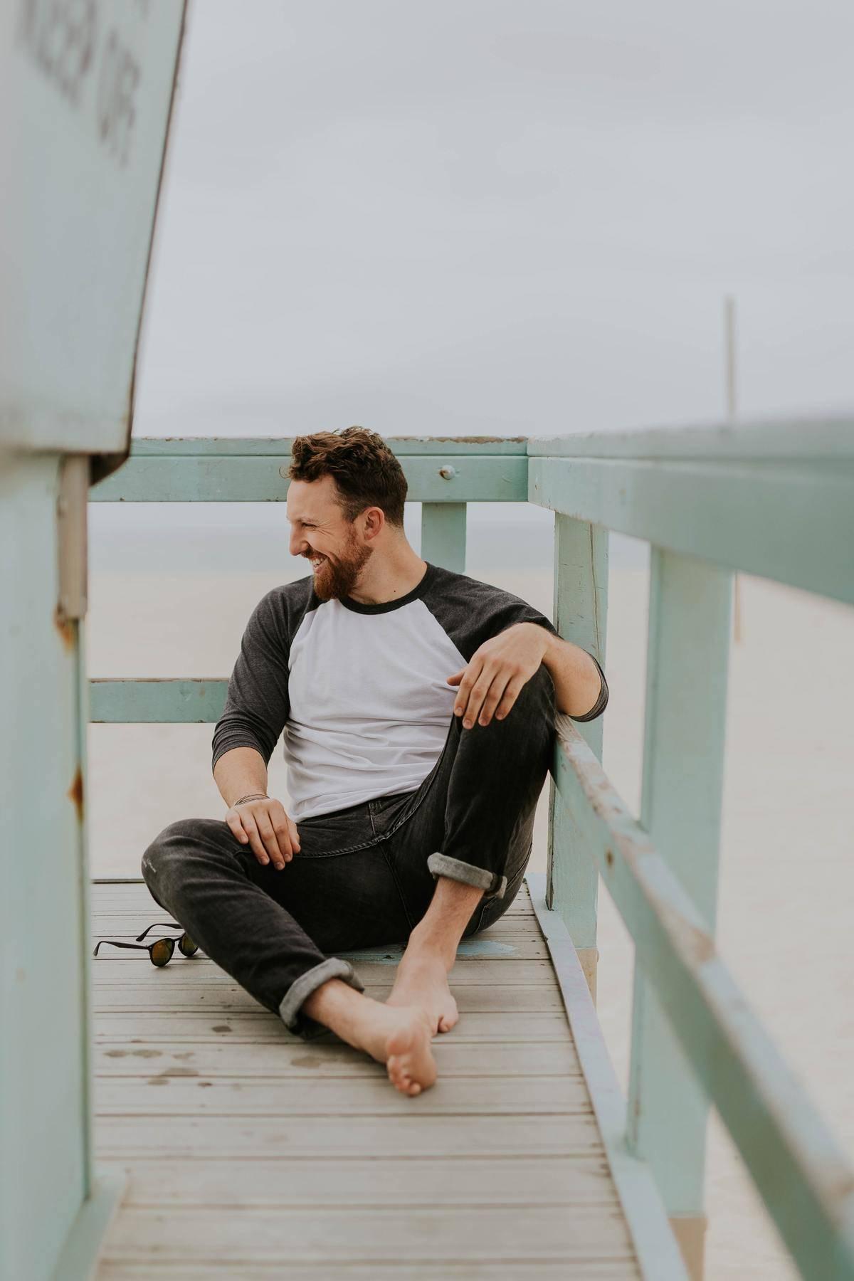 man sitting on dock smiling