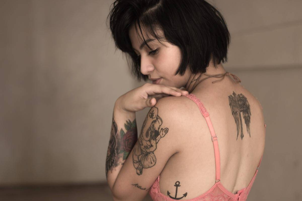 a woman with tattoos