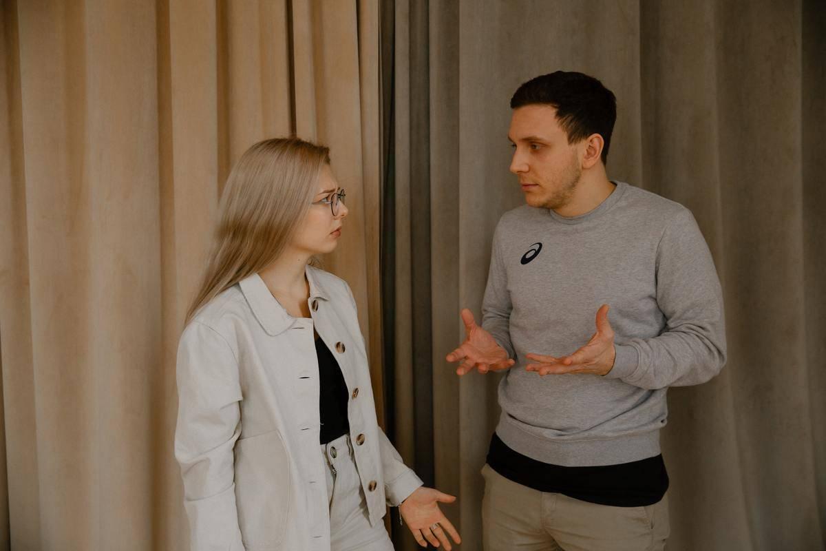 man and woman talking animatedly