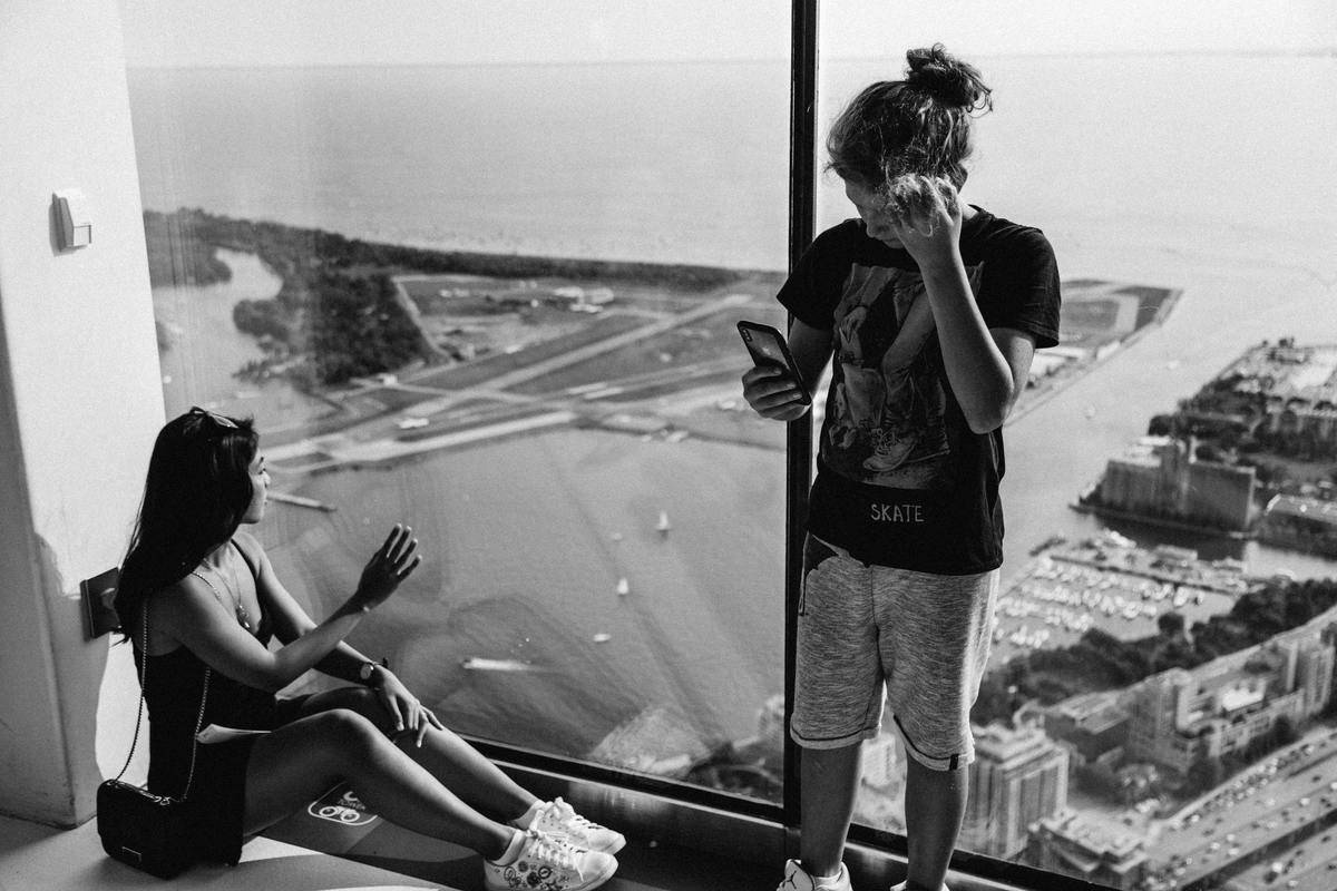 couple looking away at top of tower