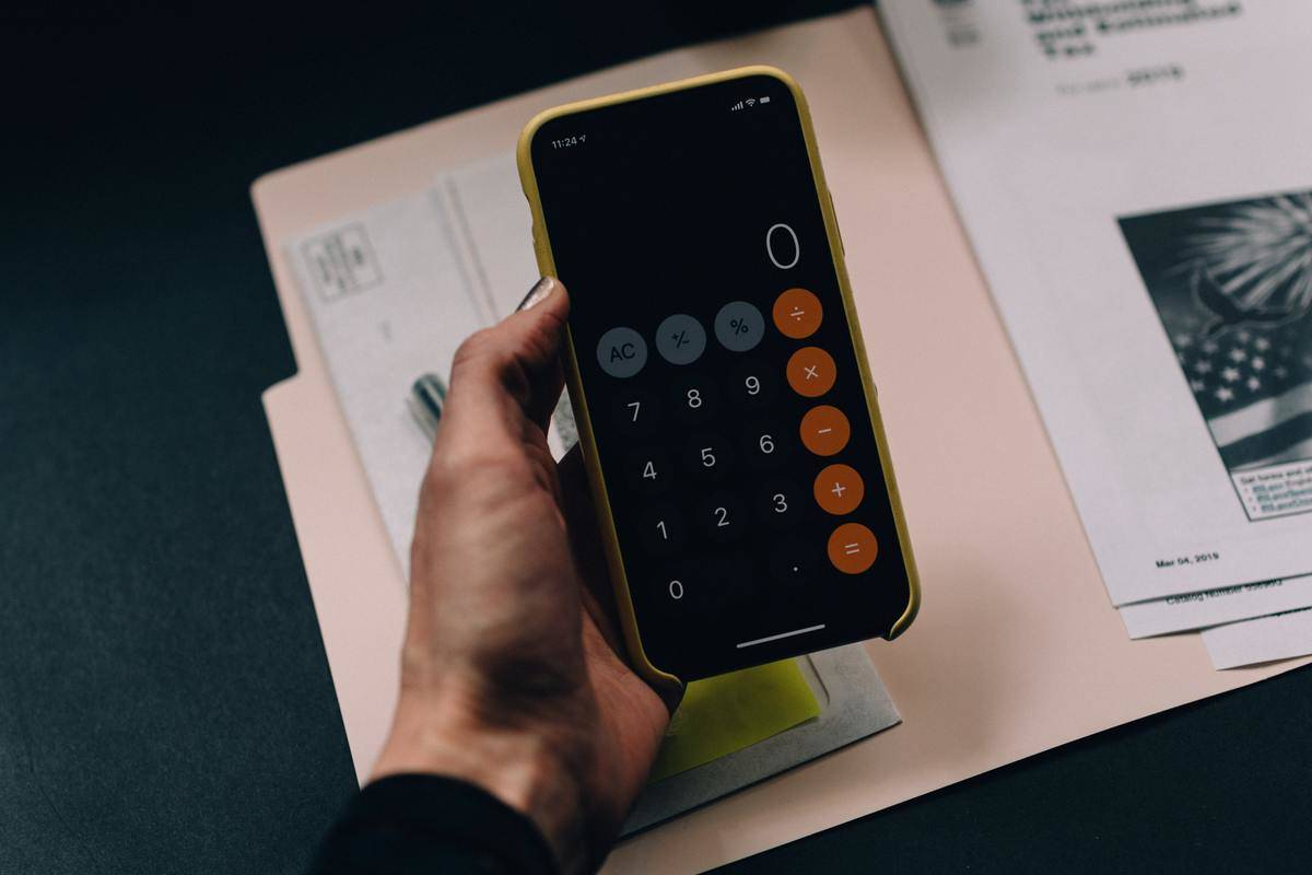 person holds calculator in their hand