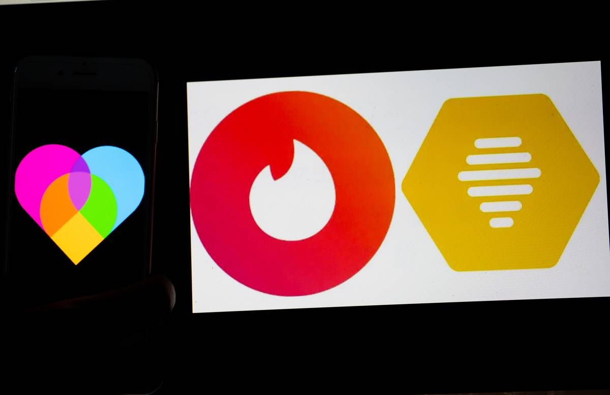 The logos of the dating apps Lovoo, Tinder and bumble