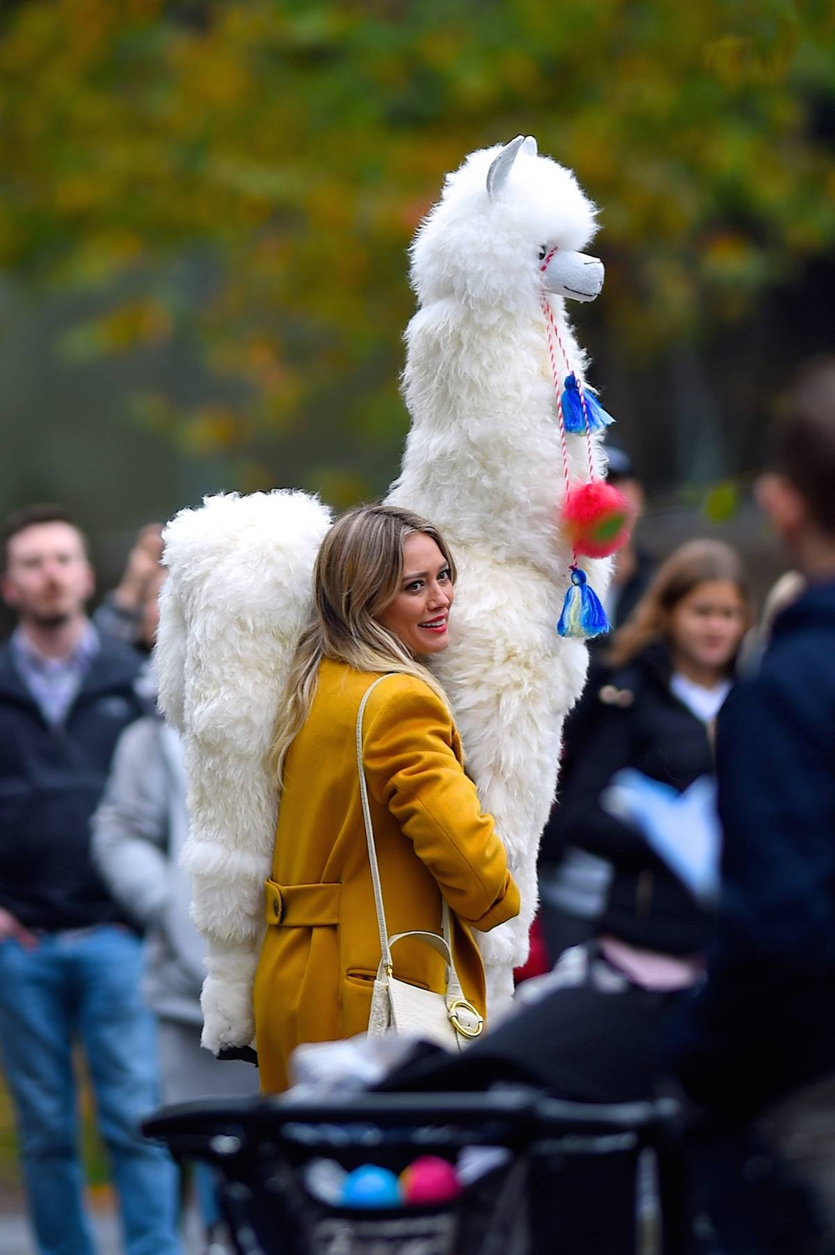 woman carrying large stuffed animal