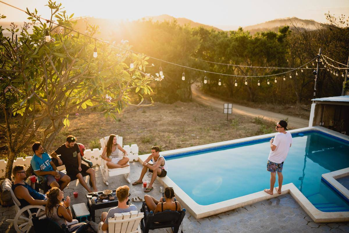 man stands alone at pool party