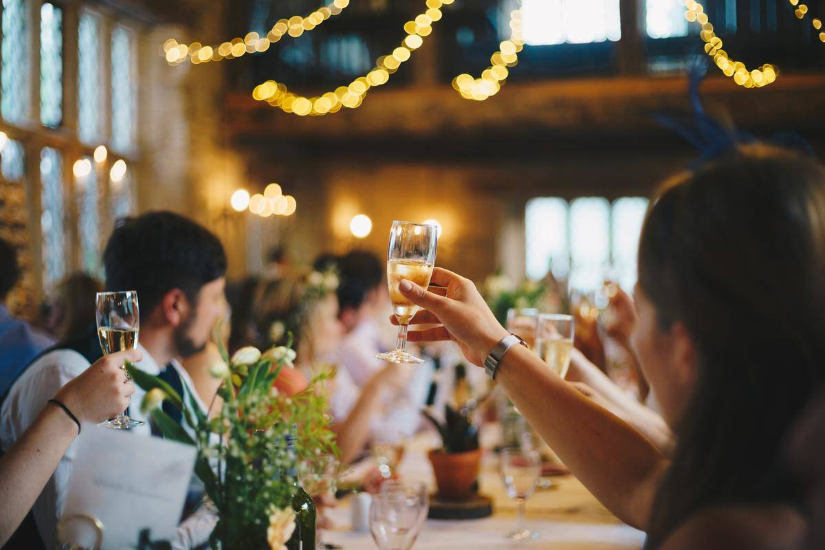 guests raise a glass at wedding reception