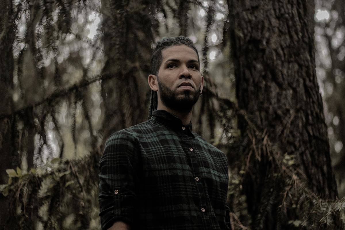 a guy standing in the forest