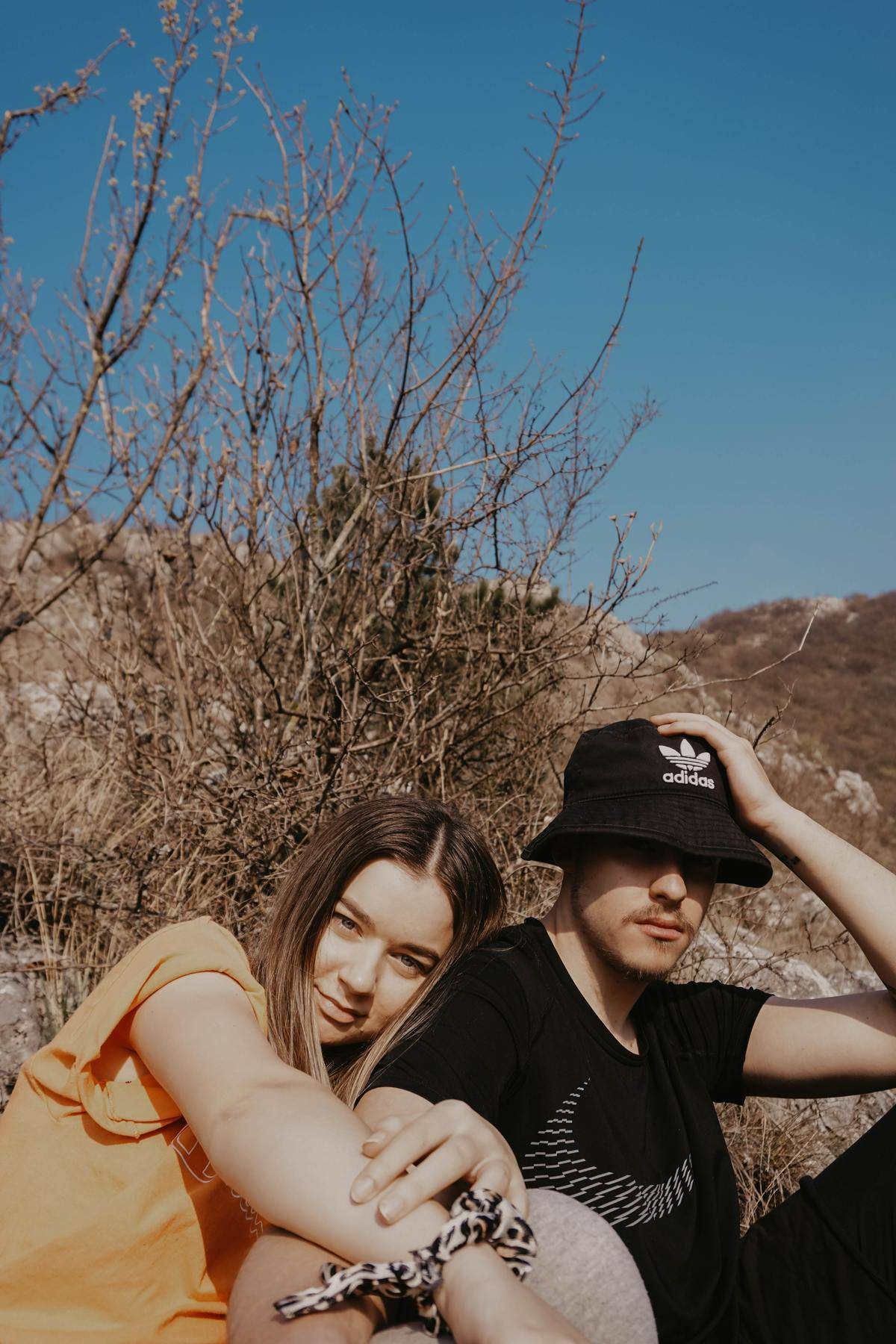 couple hanging out in the desert