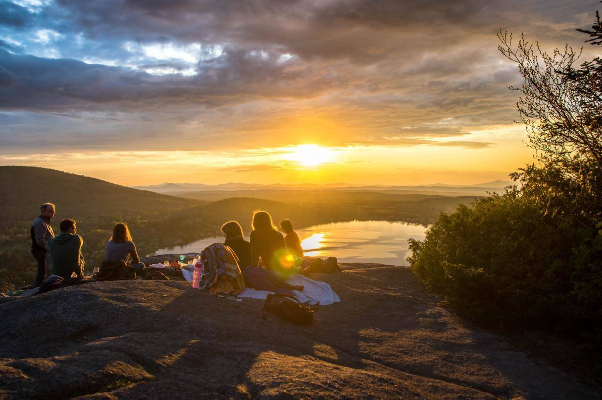 Group of friends sit in scenic spot