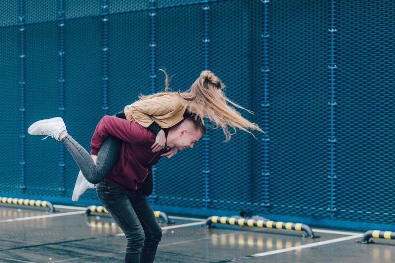 guy giving a girl a piggyback