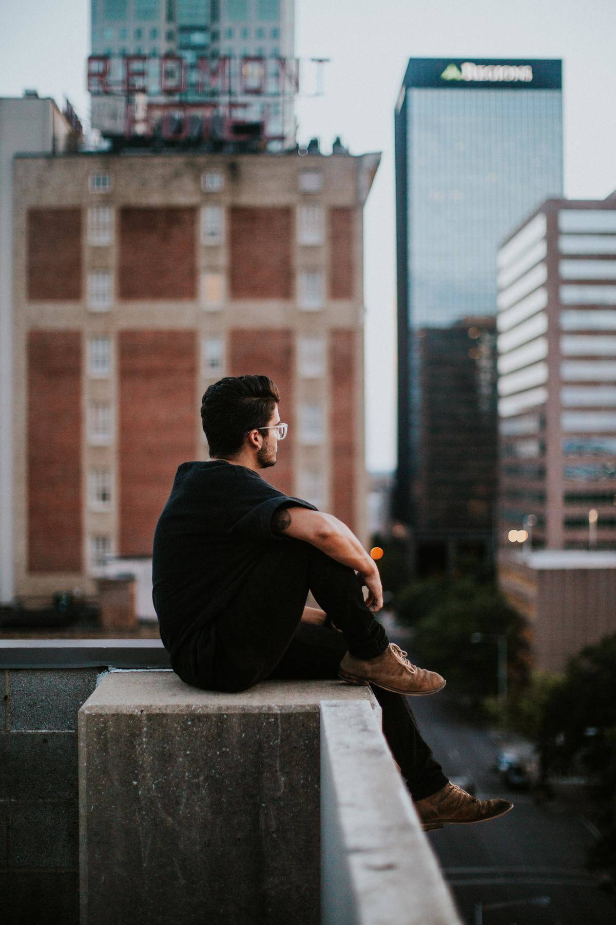 guy looking out at buildings