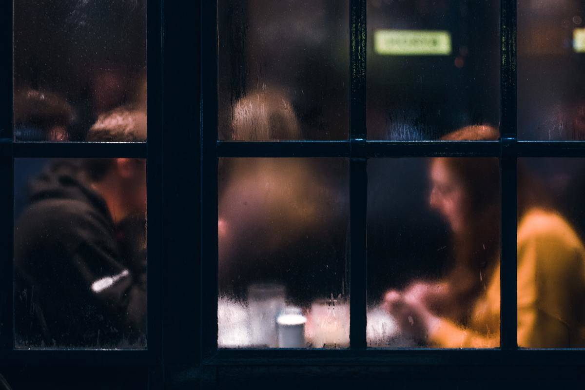 a picture of a couple through a window