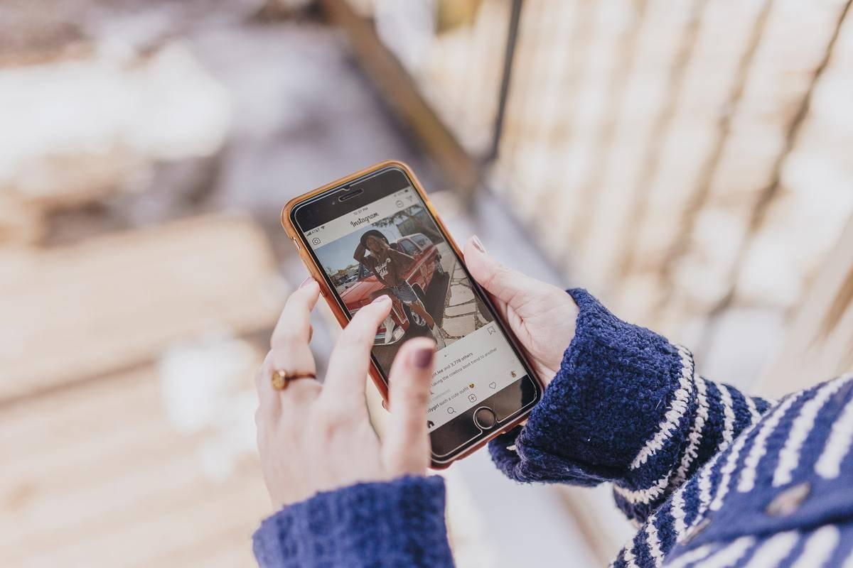 Woman scrolls through Instagram