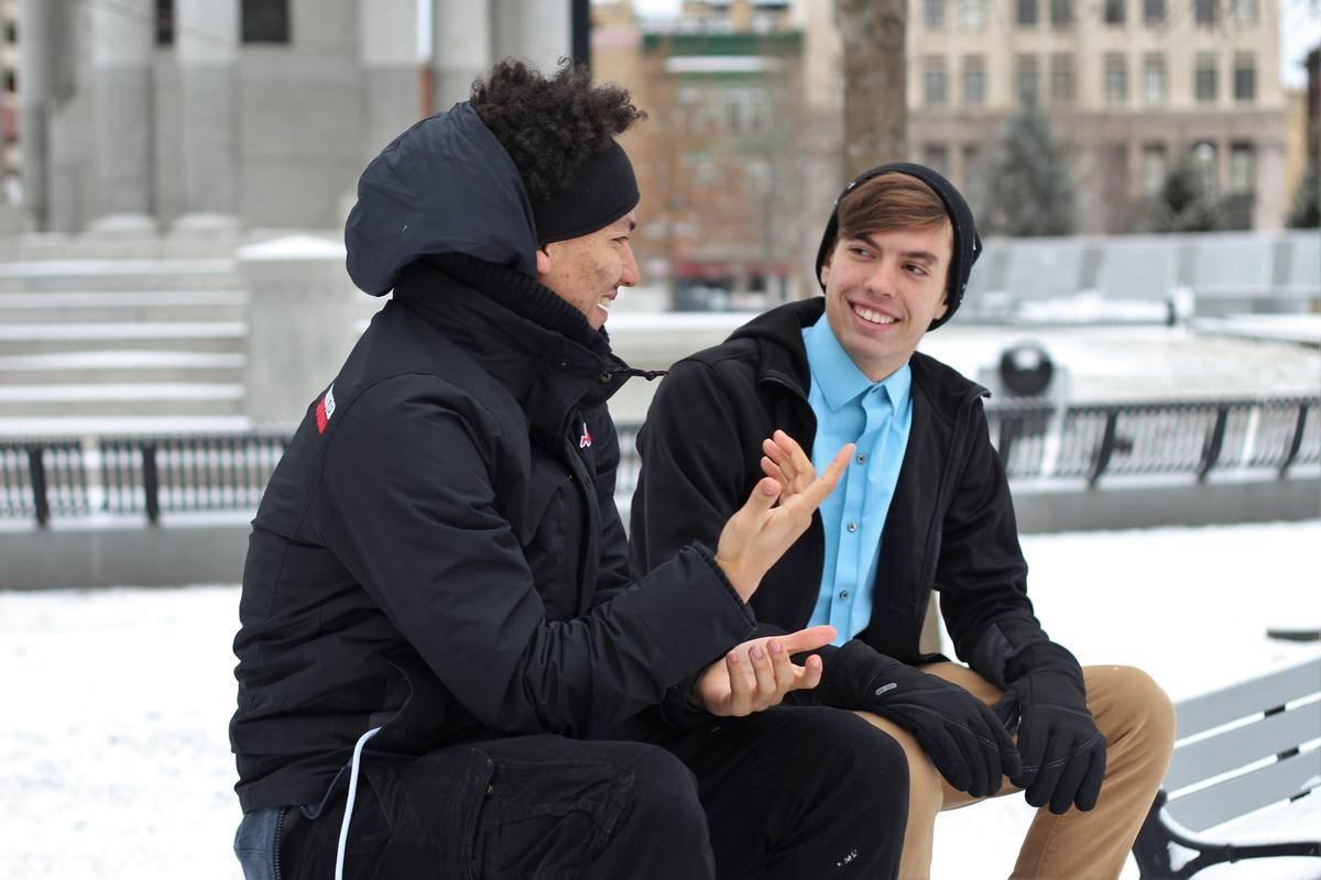 men seated outside talking