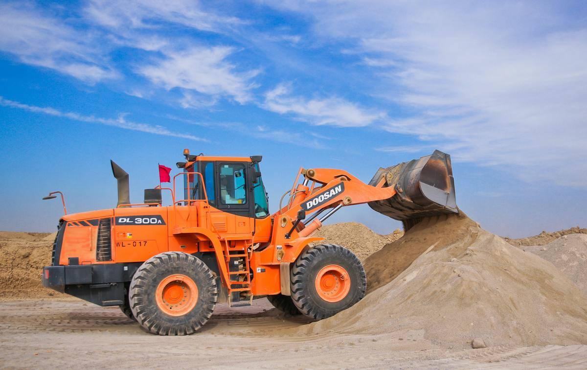 construction vehicle dumping dirt