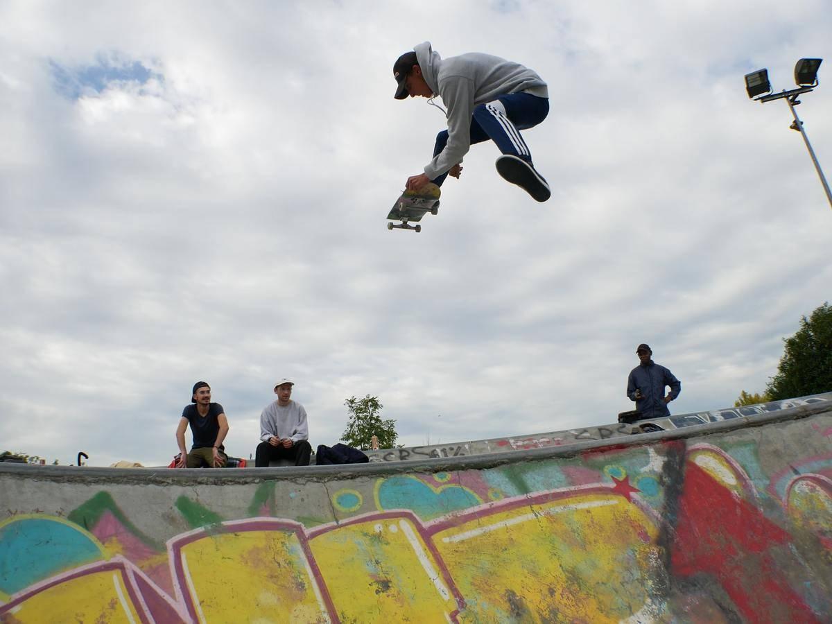 man skateboarding at skatepark