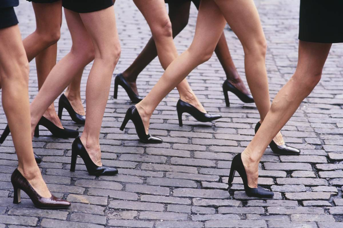 Close-up of models' bare legs with short skirts and high heel