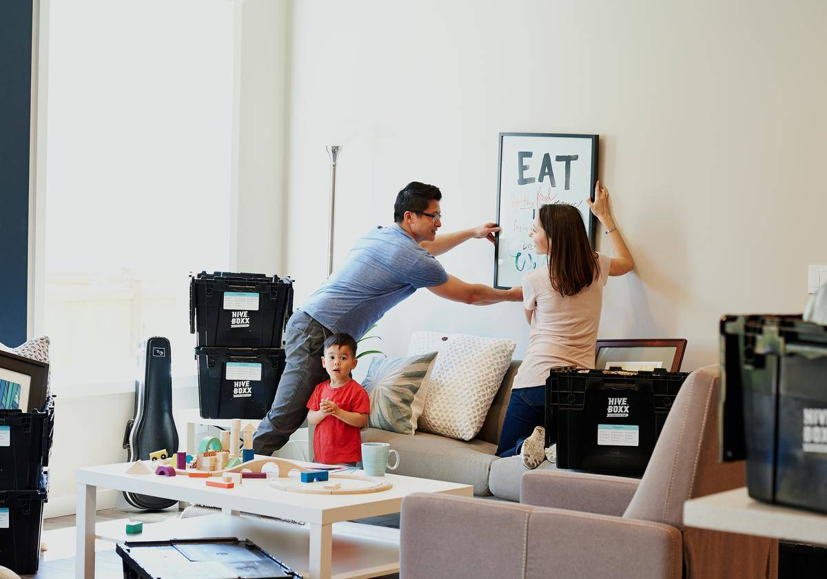 Couple put up painting in family room