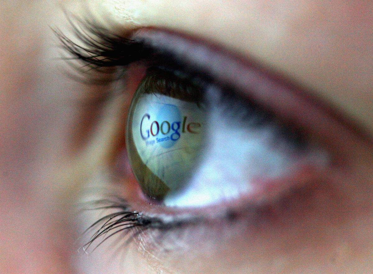 Google logo is reflected in the eye of a girl
