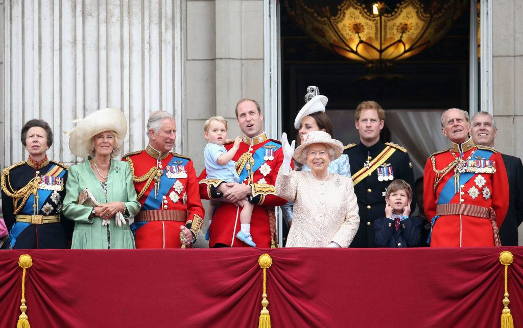 The Royal Family waves in balcony