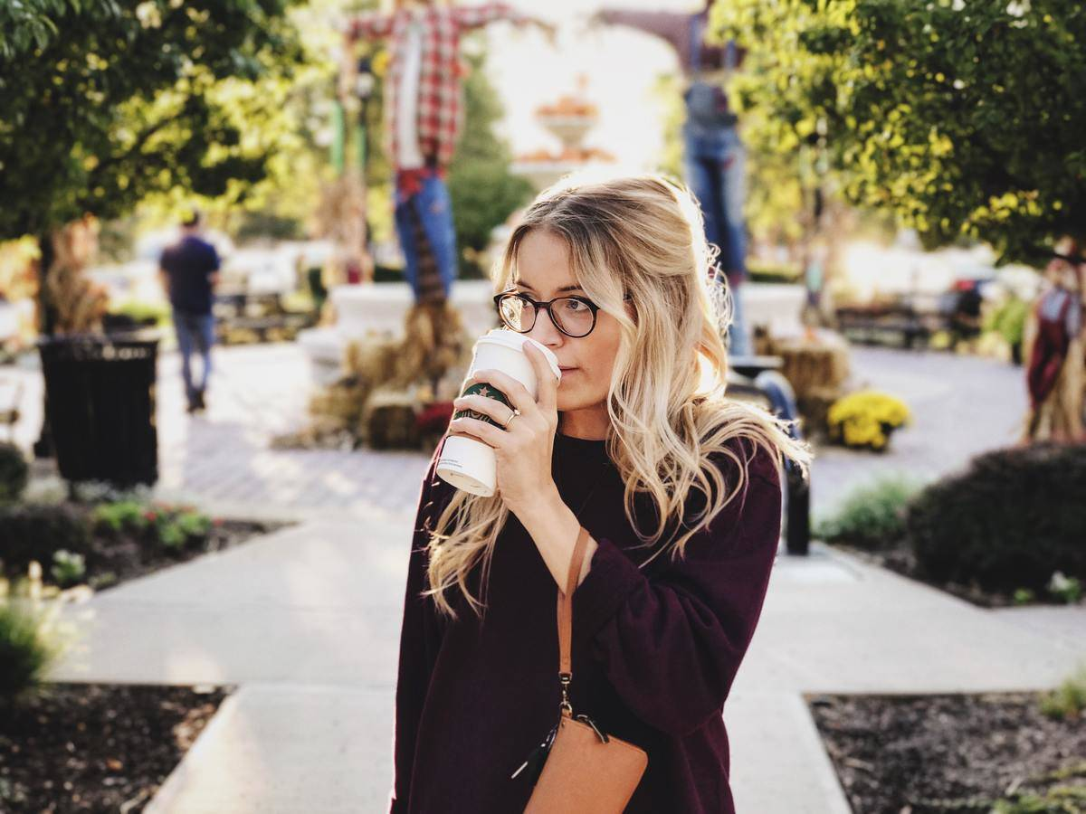 walk walks with coffee in hand