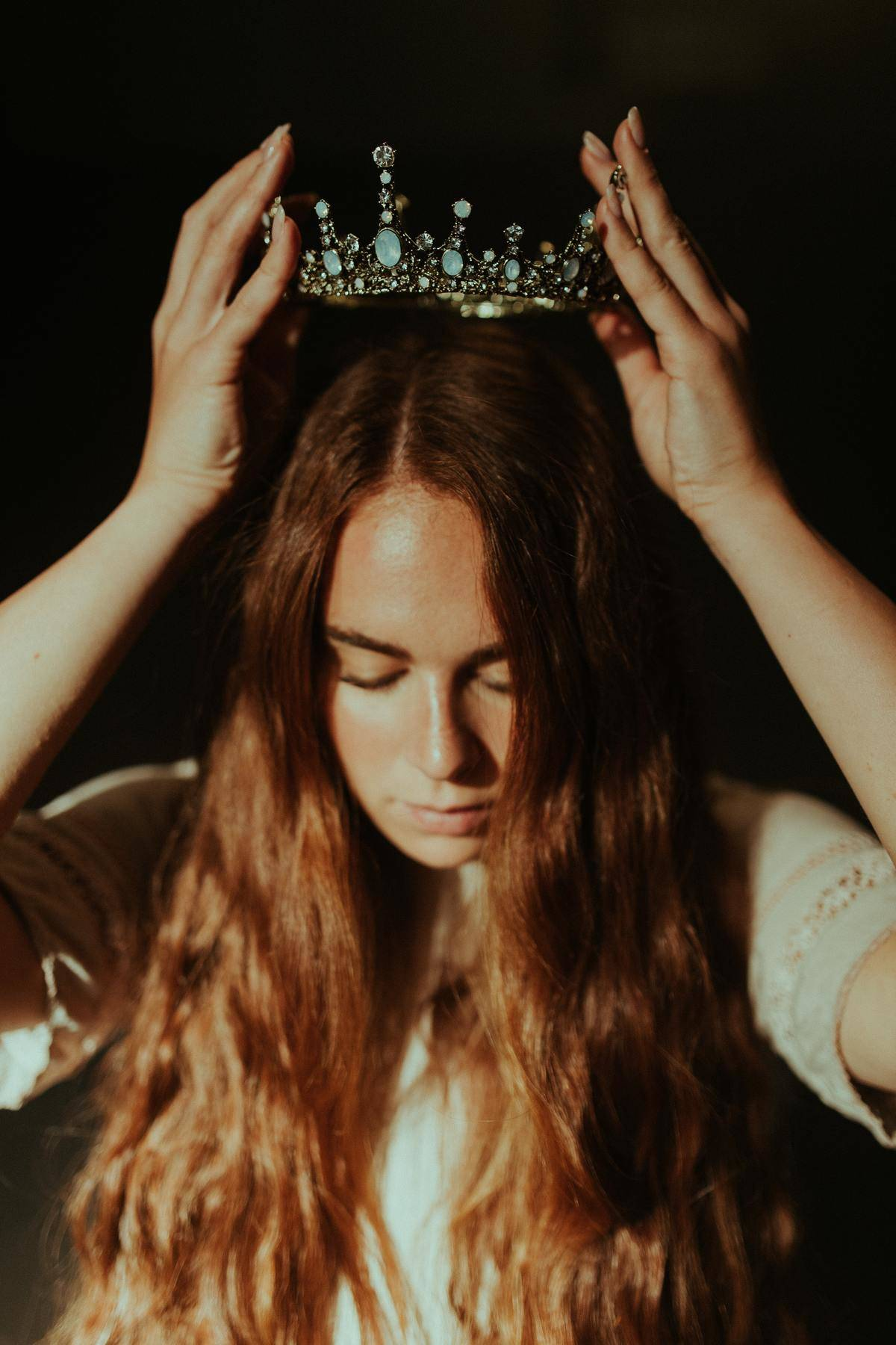 woman puts on her crown