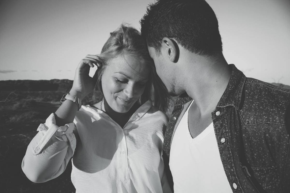 black and white couple woman looking down
