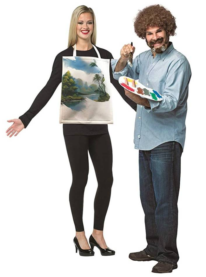 man dressed as Bob Ross with artist palette and woman with painting hanging from neck