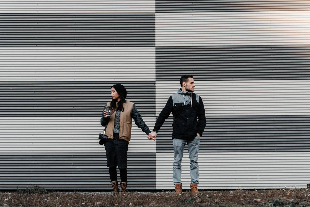 couple standing in front of a building