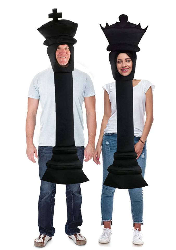 man and woman dressed as king and queen chess pieces