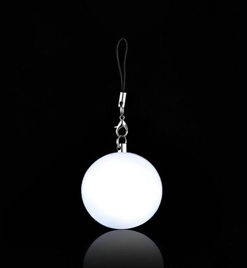 circular light in dark on a string