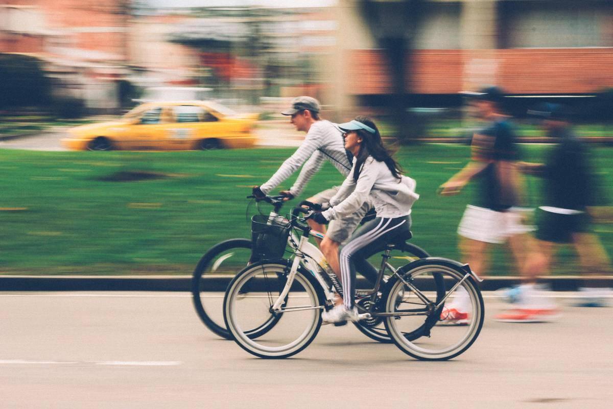 couple biking through city