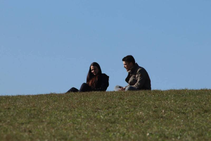 couple seated on hillside