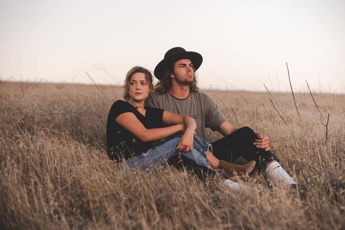 couple sitting in a field together