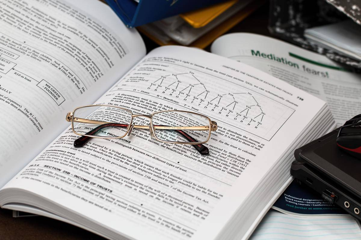 glasses sitting on open book