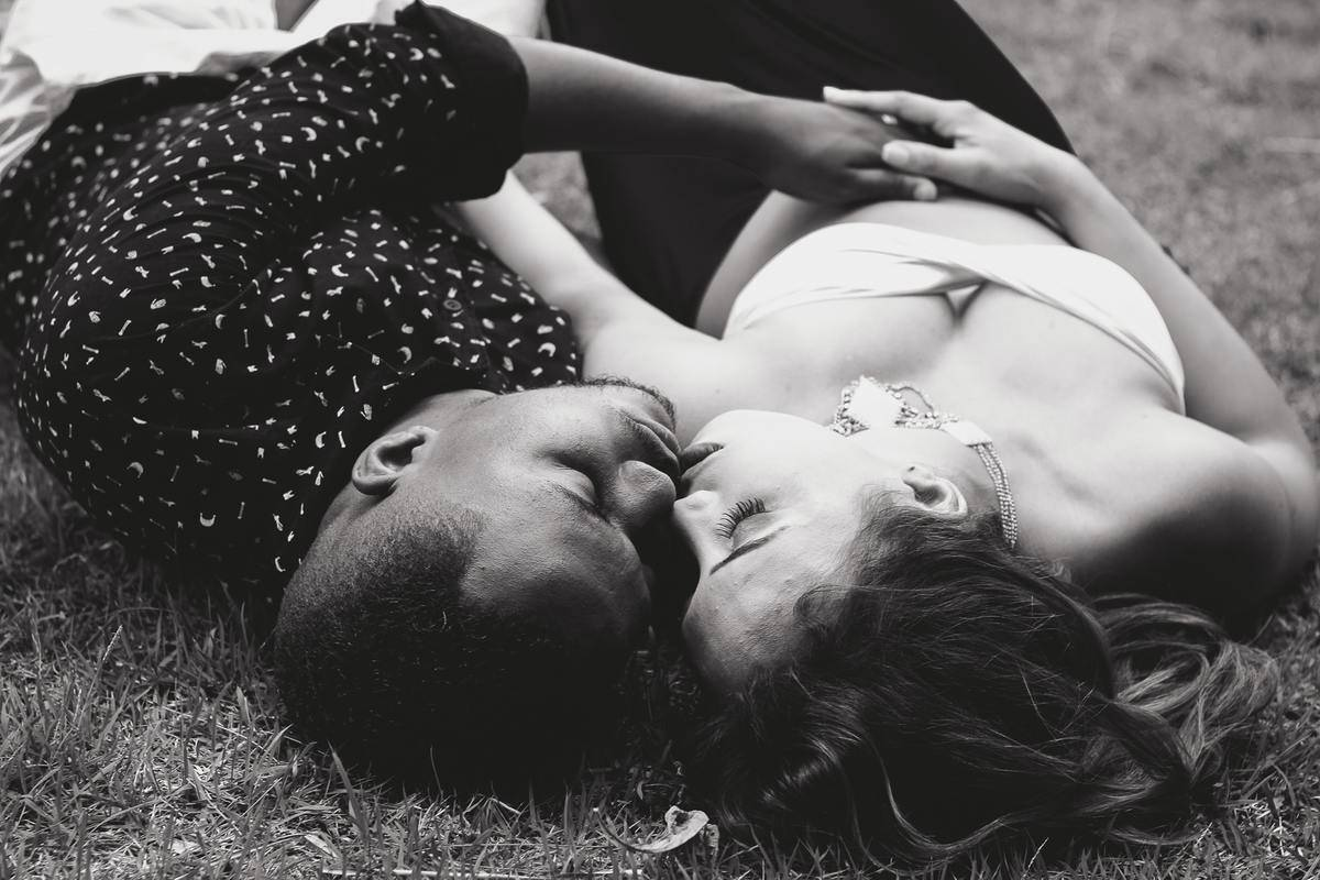 couple lying down in some grass