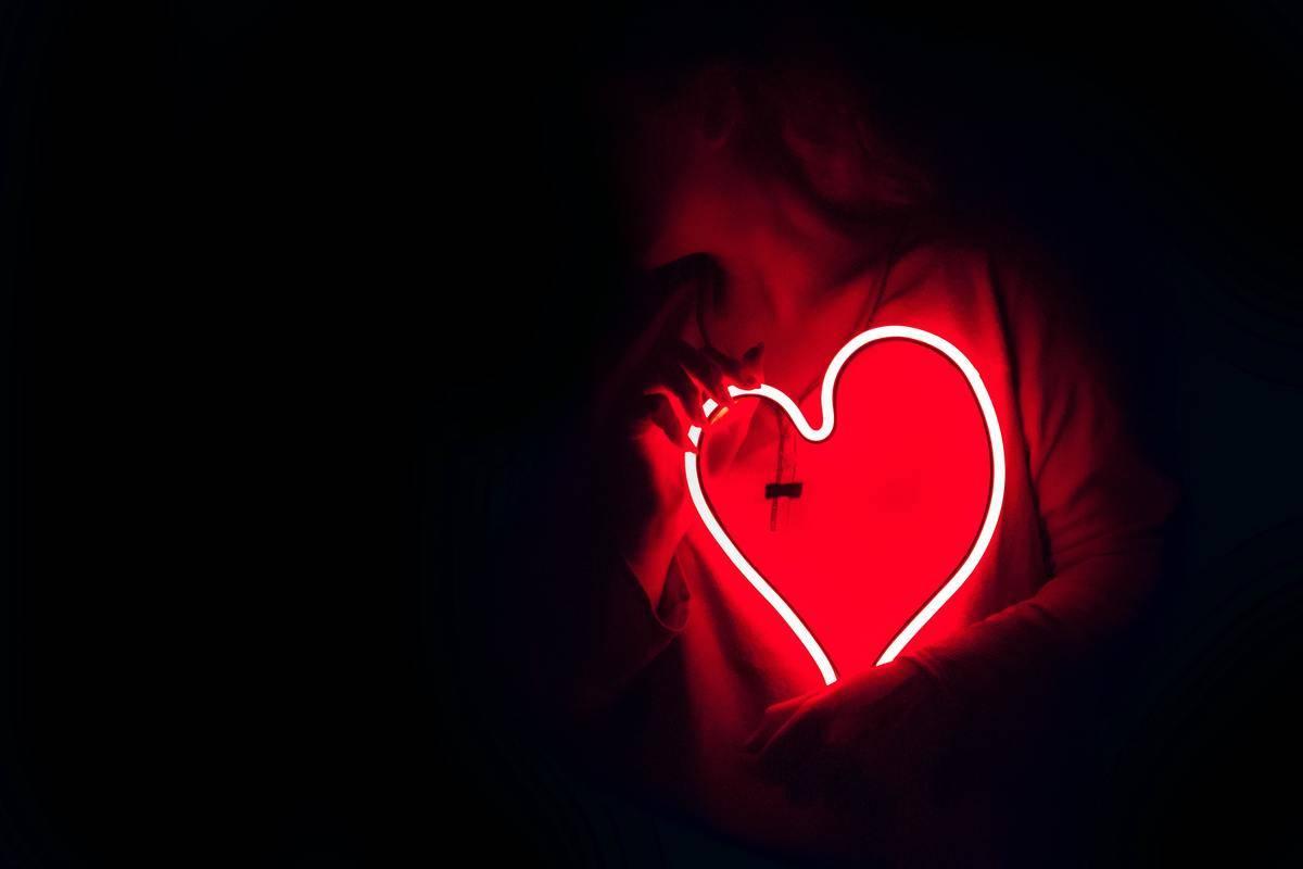 holding a lit heart