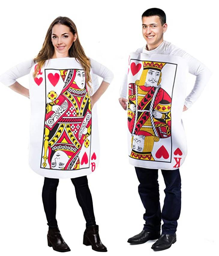 man and woman respectively dressed as king and queen of hearts cards