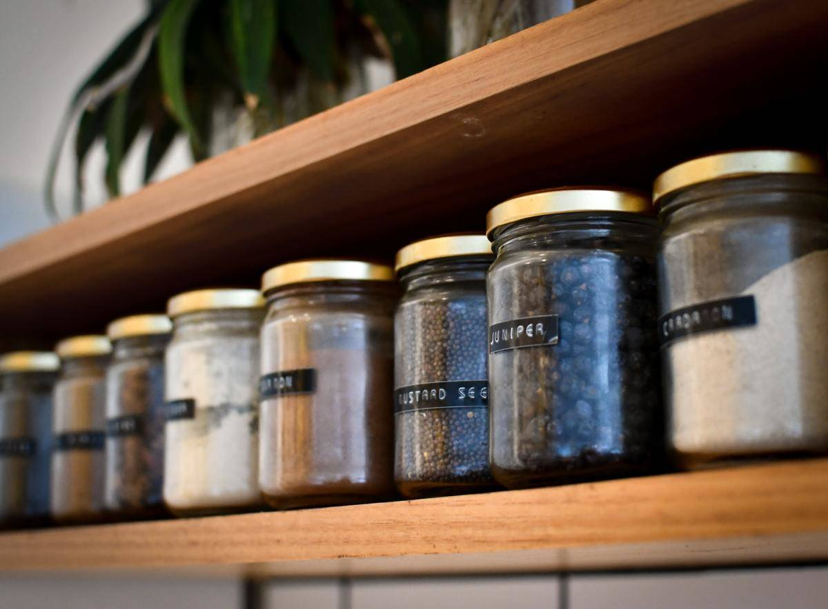 jars of labelled spices on shelf