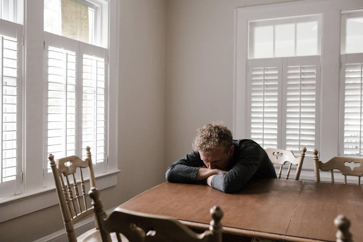 man  sad at table